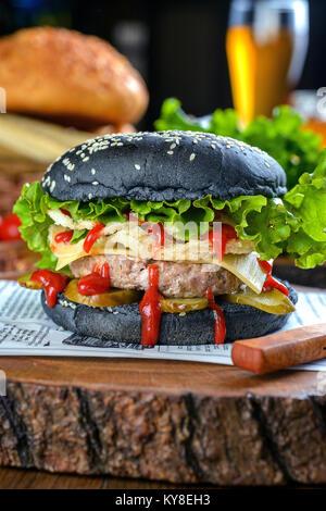Big juicy blackburger - Stock Photo