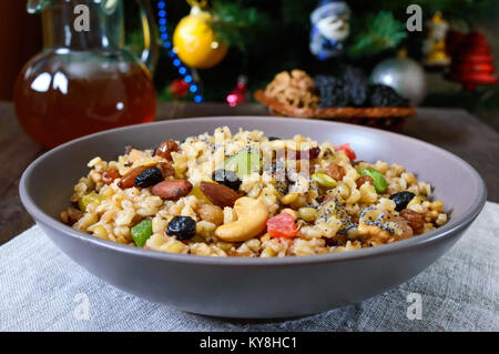 Wheat porridge with different nuts, dried berries, poppy seeds, raisins, honey. Kutya. Christmas dish of the Slavs. - Stock Photo