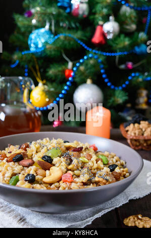 Wheat porridge with different nuts, dried berries, poppy seeds, raisins, honey. Kutya. Christmas dish of the Slavs. - Stock Photo