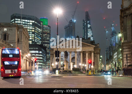 London, England, UK - January 11, 2018: Traffic passes the Bank of England and Royal Exchange in the City of London, - Stock Photo