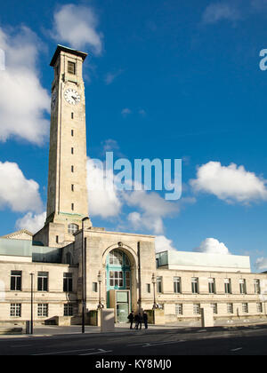 Southampton, England, UK - February 16, 2014: Sun shines on the art deco facade and clock tower of the west wing - Stock Photo