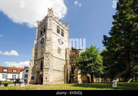 London, England - July 28, 2014: The 16th-century tower and west front of Waltham Abbey Church. - Stock Photo