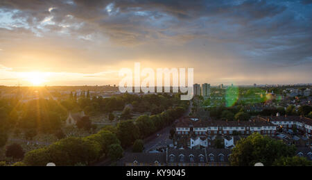 Sunset under stormy skies in Tooting, south west London, with Blackshaw Road and Lambeth Cemetery leading into a - Stock Photo
