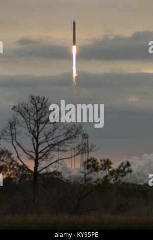 The Orbital ATK Antares launch vehicle lifts off of Launch Pad 0 from the Mid-Atlantic Regional Spaceport en route - Stock Photo