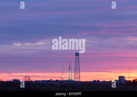 Sunrise over Orbital ATK's Antares launch vehicle, on launch pad 0 at the Wallops Spaceport, as it prepares to launch - Stock Photo