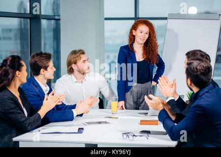 Presentation in business seminar analysing flipchart - Stock Photo