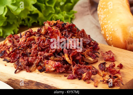 Heap of bacon and onion toppings - Stock Photo