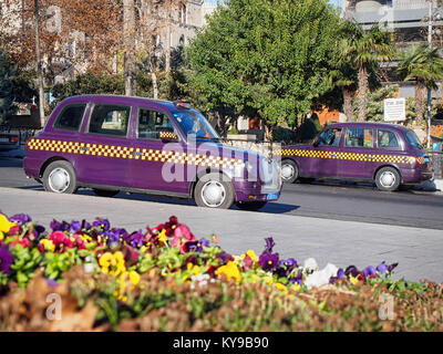 Famous Baku violet taxi cars on the city streets - Stock Photo