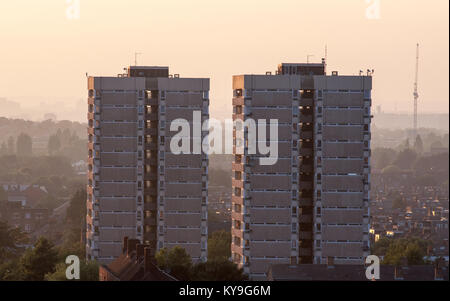 London, England, UK - June 20, 2013: A pair of high-rise council estate tower blocks stand over streets of terraced - Stock Photo