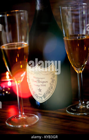 SOFIA, BULGARIA - OCTOBER 29, 2017: Dom Perignon Vintage 2006 champagne bottle and two glass, lights and bokeh from - Stock Photo