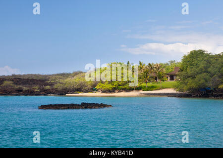 A small and secluded private beach near Makena in Maui, Hawaii. The area with its lava rock coastline is famous - Stock Photo
