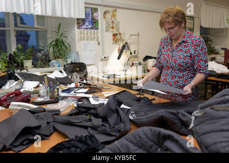 Apparel cutter at work in the Alexandrinsky theatre, St. Petersburg, Russia - Stock Photo