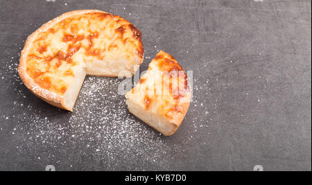 fresh rice pie on a dark grey table - Stock Photo