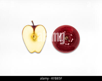 Red apple Top view One whole juicy red apple and half of apple are lying on a white background Flat lay Isolated - Stock Photo