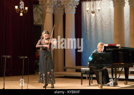 Kiev, Ukraine, November 25 2017. The girl plays the violin on stage, to the accompaniment - Stock Photo