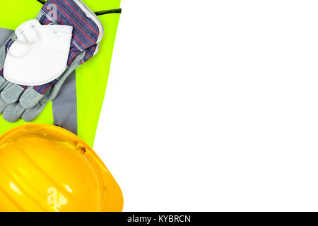 Yellow hi vis vest and hard hat with safety gloves and a dust mask isolated on a pure white background - Stock Photo