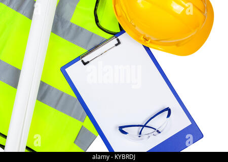 Yellow hi vis safety vest and hard hat with glasses and a clipboard with copyspace - Stock Photo