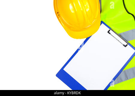 Saftey yellow hi vis vest and hard hat with a blue clipboard isolated on a pure white background - Stock Photo