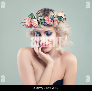 Beautiful Smiling Woman Fashion Model with Blue Eyeshadow Makeup, Pink Roses Flowers and Blonde Bob Hairstyle - Stock Photo