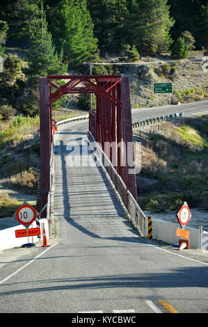 Narrow one lane single lane bridge over Clutha River at Luggate on State Highway 8A. Towards Wanaka. New Zealand - Stock Photo