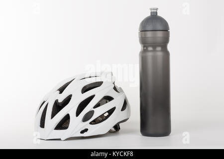 White bicycle helmet, protection of head injury on cycling and water bottle,  studio photo, isolated on background. - Stock Photo