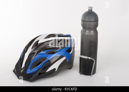Bicycle helmet, protection of head injury on cycling and water bottle, studio photo, isolated on background - Stock Photo
