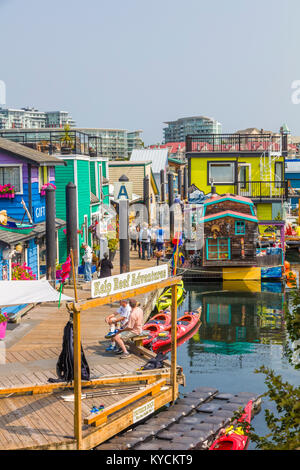 Fisherman's Wharf in Victoria Canada a tourist attraction with food kiosks, unique shops and float homes or houseboats - Stock Photo
