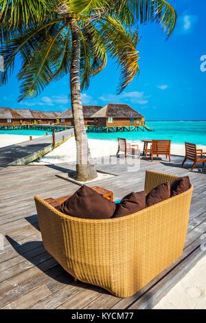 Beach bar on a holiday island resort in Maldives, Indian Ocean - Stock Photo