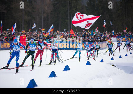 Ruhpolding, Germany. 14th Jan, 2018.  The Biathletes kick off the men's 15KM mass start competition at the BMW IBU - Stock Photo