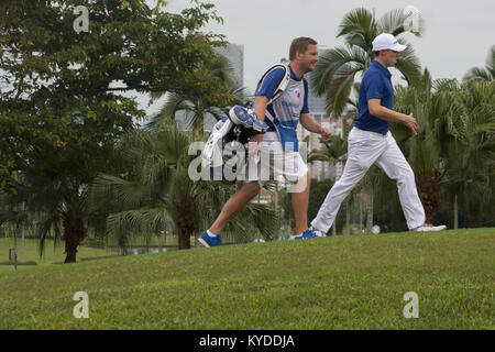 Kuala Lumpur, Malaysia. 14th Jan, 2018. Matt Fitzpatrick is seen walking to another hole with his caddie on the - Stock Photo