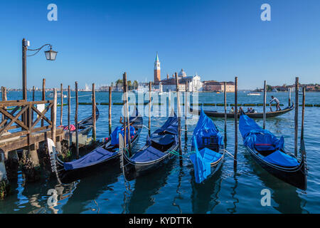 Parked gondolas and the Church of San Giorgio Maggiore in Veneto, Venice, Italy, Europe, - Stock Photo
