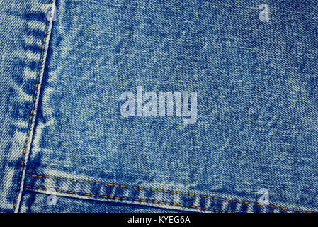 Textured vintage background - blue jeans textile denim with seam of fashion design in close-up (high details). - Stock Photo