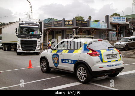 Knysna Western Cape South Africa. December 2017. Police car and office directing traffic in the main street. - Stock Photo