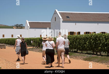 Paarl, Western Cape, South Africa. December 2017. Tourists on a wine tour of Babylonstoren estate. - Stock Photo