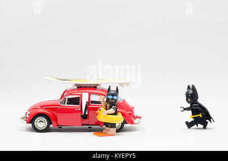 lego vacation batman and batman with his guitar going on holiday. isolated on white background. - Stock Photo