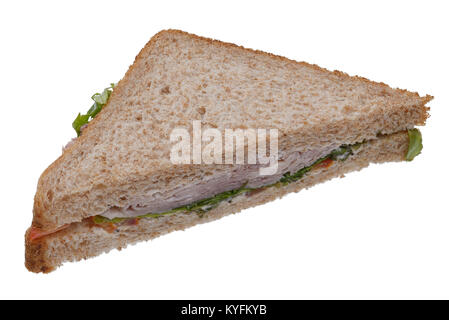 Shop bought ham and salad sandwich on brown bread - Stock Photo