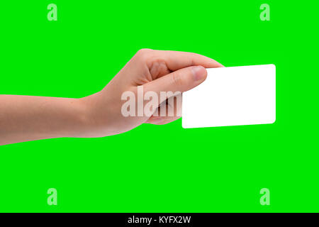 Hand hold business card, credit card or blank paper isolated on green background with clipping path. - Stock Photo
