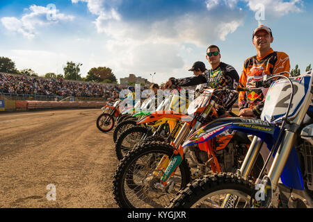 Rivne, Ukraine - 11 October 2015: Unknown riders  during a prepare for the race at the Open Cup Speedway to the - Stock Photo