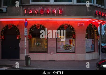Neon restaurant lights in Luxembourg - Stock Photo