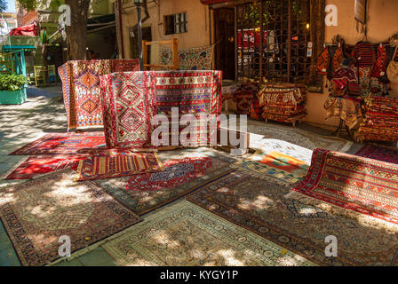 Carpets on the street market in Tbilisi. - Stock Photo