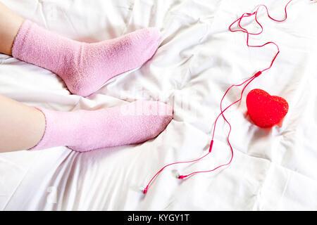 Female Feet In Pink Woolen Socks By The Window Retro Style Tonal