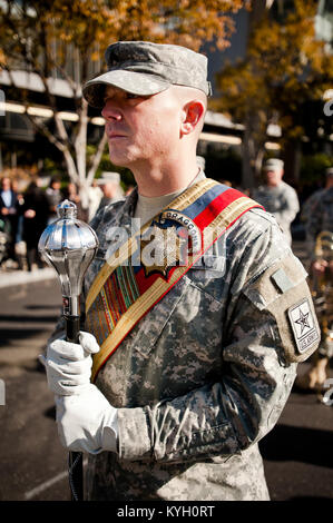 A parade marshal assigned to the 113th Army Band stands ready to march down Main Street in Louisville, Ky., on Nov. - Stock Photo