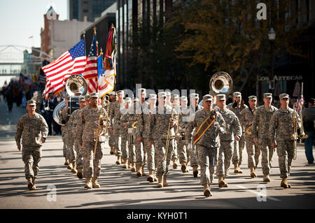 The 113th Army Band marches down Main Street in Louisville, Ky., on Nov. 11, 2011, during the city's Veterans Day - Stock Photo