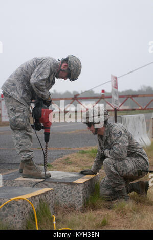 Civil engineers from a Joint Assessment Team test slabs of concrete on the runway at Lakehurst Naval Air Engineering - Stock Photo