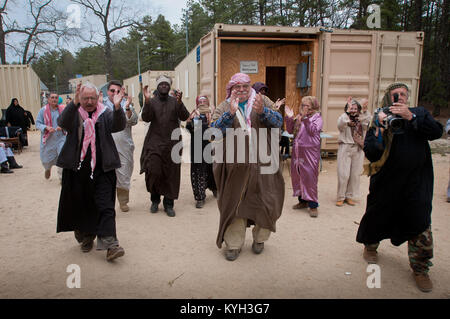 Actors, playing the roles of Arabic citizens in the fictional village of Sabor, Nessor, bid farewell to members - Stock Photo
