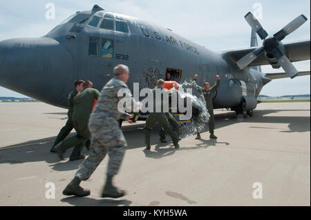 Members of the 123rd Airlift Wing douse Col. Greg Nelson with water and champagne on the flight line of the Kentucky - Stock Photo