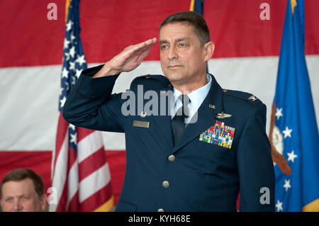 Col. Warren H. Hurst receives his first salute as commander of the 123rd Airlift Wing during a change-of-command - Stock Photo