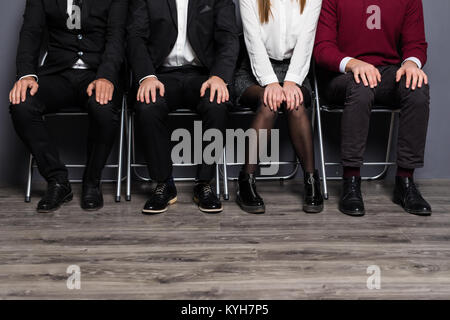 Cropped View of Business People Sitting in Row - Stock Photo