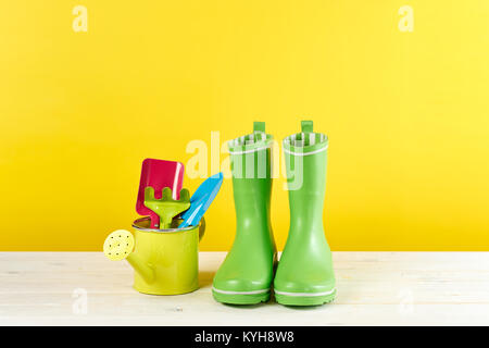 Gardening tools and rubber boots - Stock Photo
