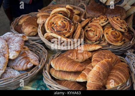 Croissants, pain au raisin and almond croissants on sale at Stockbridge Sunday Market in Edinburgh, Scotland, UK. - Stock Photo